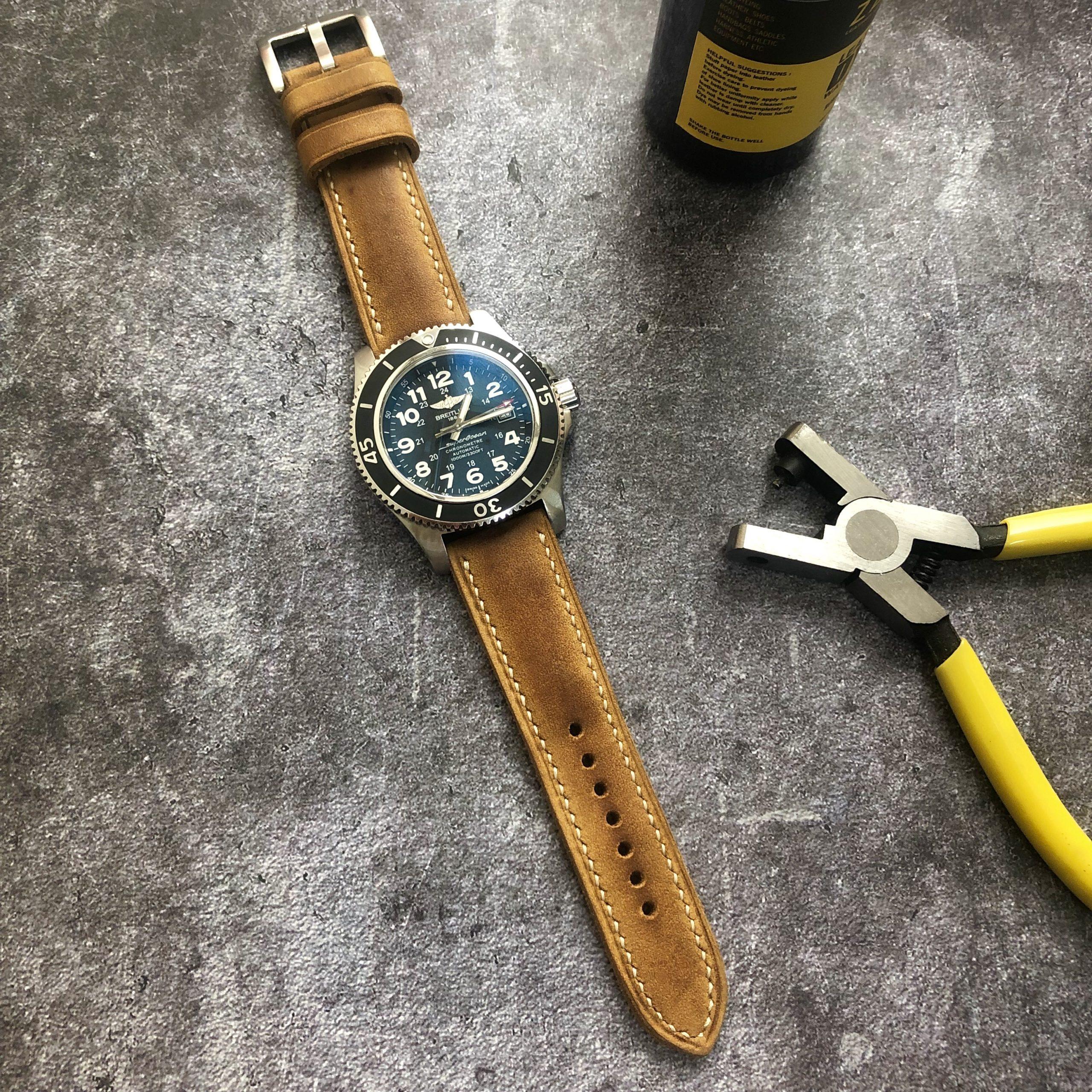 1 porteur-straps-assolutamente-breitling